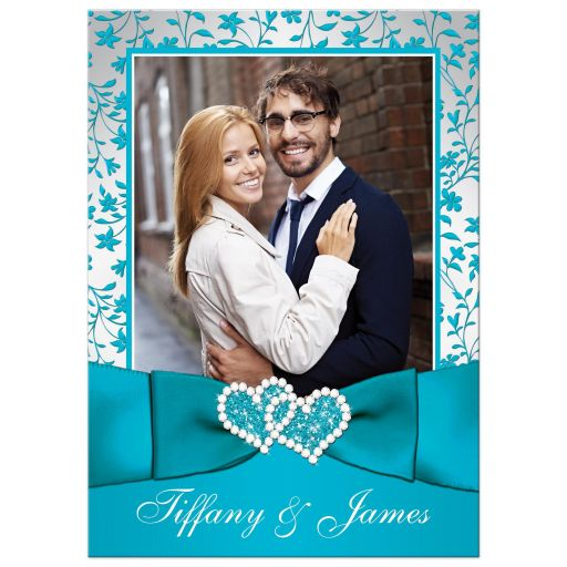 Teal blue and silver grey floral wedding invitation with joined jewel hearts, ribbon, bow and photo template.