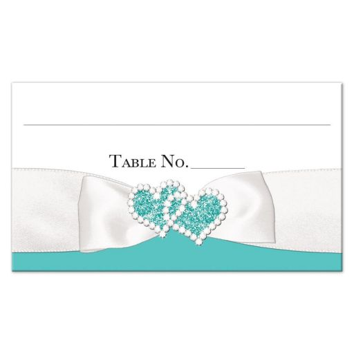 Tiffany blue and white flat place cards or escort cards with a white satin look ribbon and bow with joined jeweled hearts brooch with diamonds and glitter.