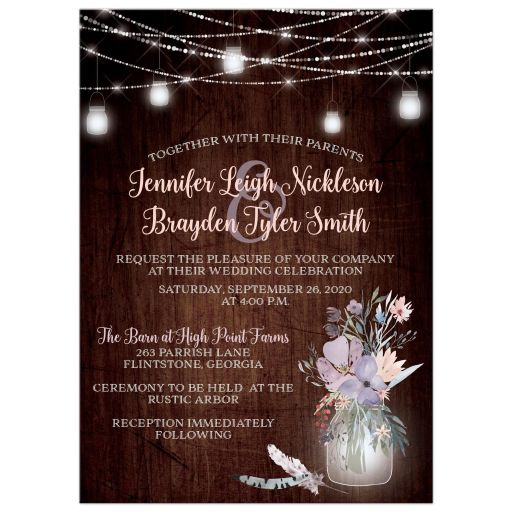 Rustic wedding invitation with brown wood, mason jars, string lights and purple, pink, blue, peach and green flowers, foliage, and feathers for a barn or country wedding.