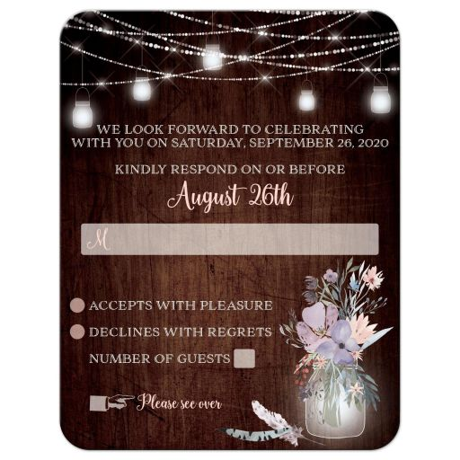 Rustic brown wood, mason jars, string lights and purple, pink, blue, peach and green flowers, foliage, and feathers wedding RSVP response reply enclosure card for a barn or country wedding.