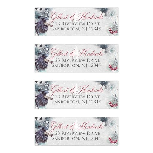 ​Winter fantasy address labels in black and grey watercolors with a messenger raven, snowflakes, snow, and red berries for a winter wedding.