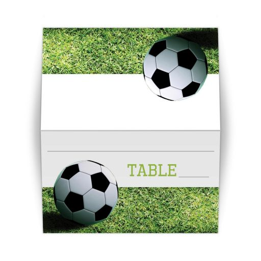 Soccer theme folded place card or escort card with a black and white soccer ball on green grass.