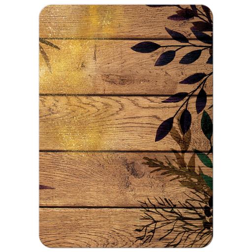 Splash of glitter on silhouette of leaves on rustic wooden slats