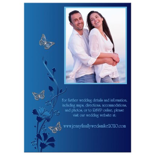 Modern white and blue photo wedding invitation with navy blue and royal blue flowers and silver butterflies on it.