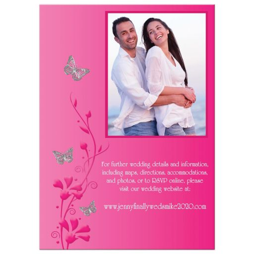 ​Modern white and hot fuchsia pink photo wedding invites with flowers, vines, and silver butterflies on it.