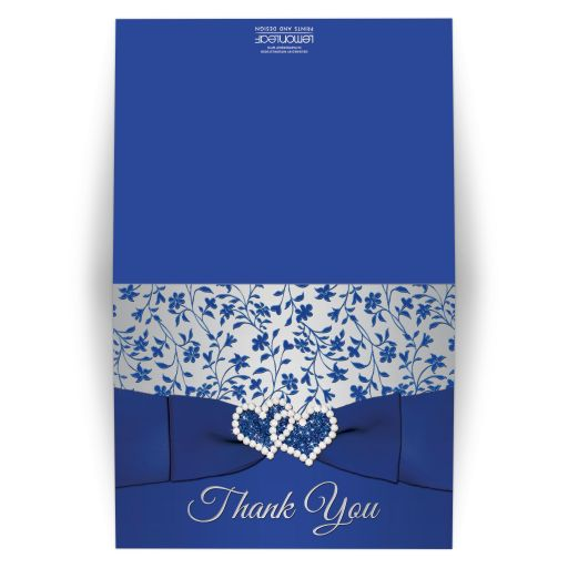 Royal blue, silver gray grey floral wedding thank you card with joined jewel and glitter hearts, ribbon, bow and ornate blue scrolls.