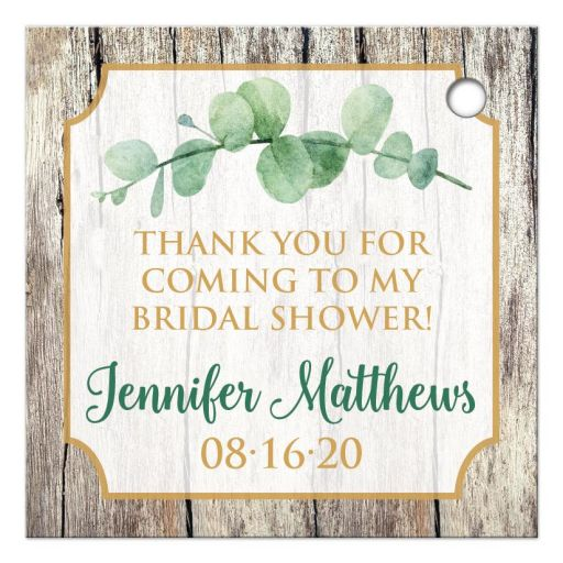 Eucalyptus branches on wood with gold hearts bridal or wedding shower favor tag.