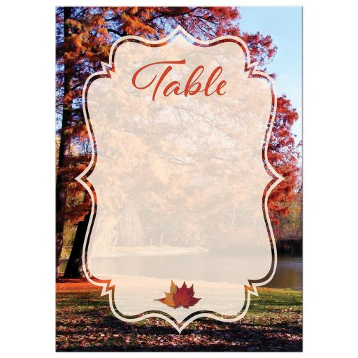 Autumn trees fall foliage wedding table number card with water, pond, or lake in burnt orange, rust, red, gold, tan, and brown.