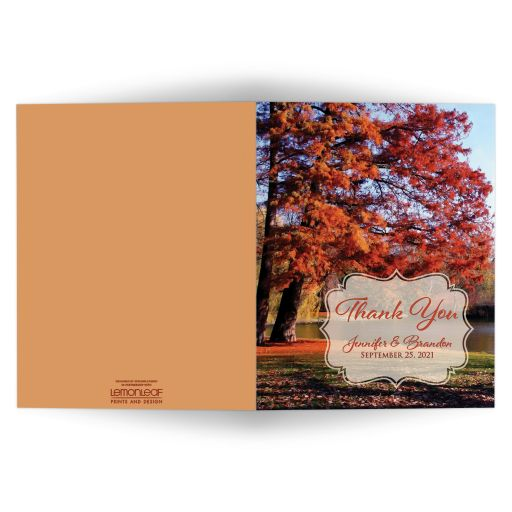 personalized autumn trees fall foliage wedding thank you card at a park with water, pond, or lake in burnt orange, rust, red, gold, tan, and brown.