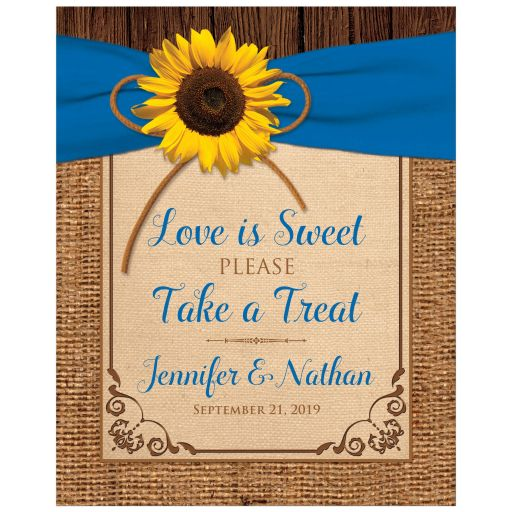 Rustic personalized burlap and wood Love is sweet please take a treat wedding favors sign with a royal blue ribbon and sunflower on it.